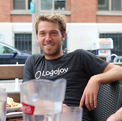 Dawson sitting on a patio smiling