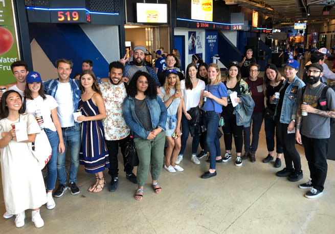 Group of people smiling at the Toronto Blue Jays game