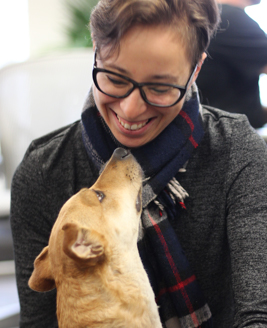 Person smiling with a dog