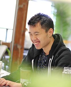 Paul smiling at his desk