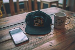 Logo on a hat and a mug
