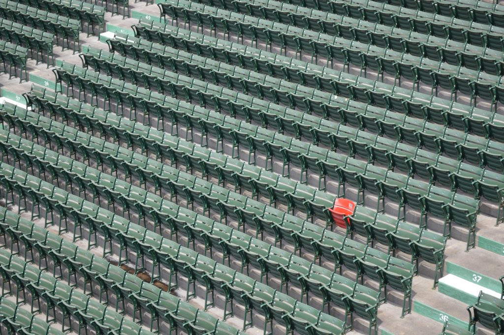 Red chair in a sea of green