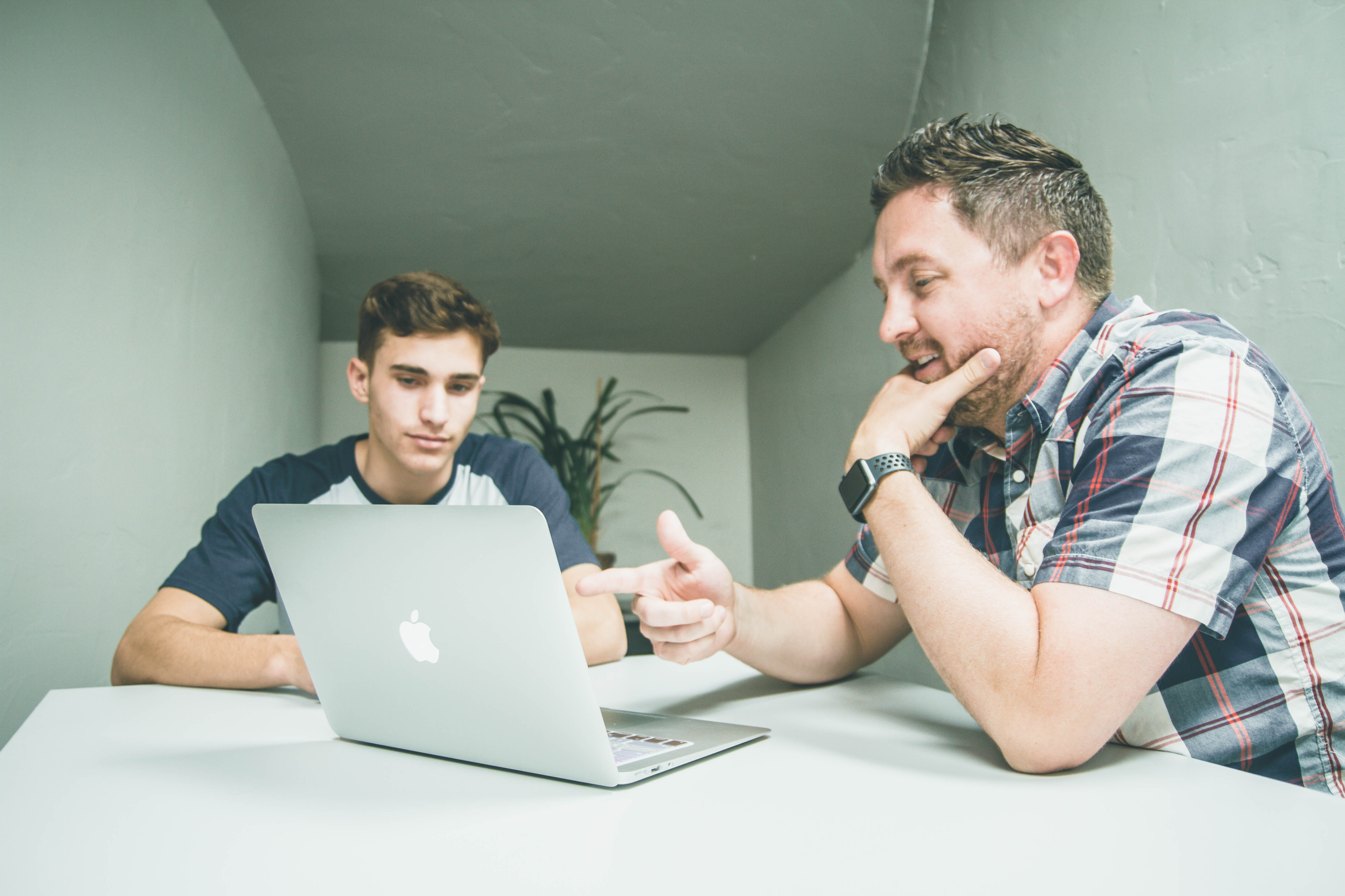 Man being tutored. Sell tutoring services online.