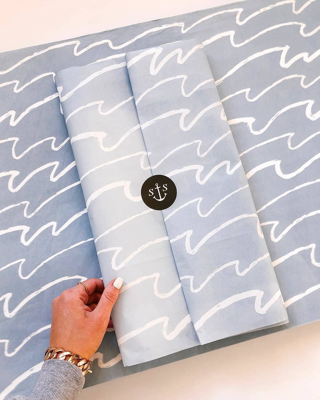 Nautical blue tissue packaging with wave design