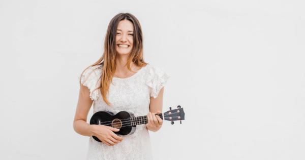 woman playing ukelele