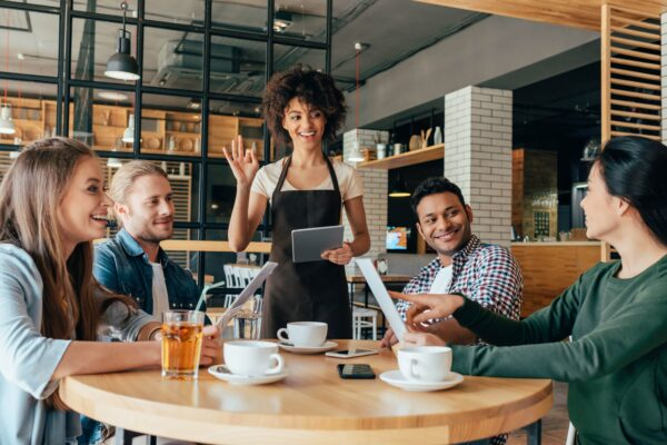 waitress greeting customers
