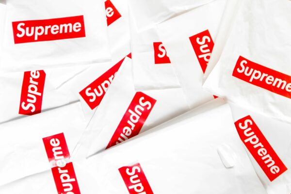 shirt with supreme logo on it