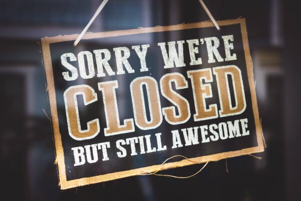 "small business sign reading ""sorry we're closed, but still awesome"""