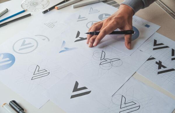 graphic designer presenting logo variations