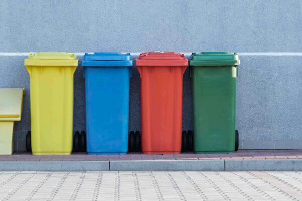 A row of colored trash bins