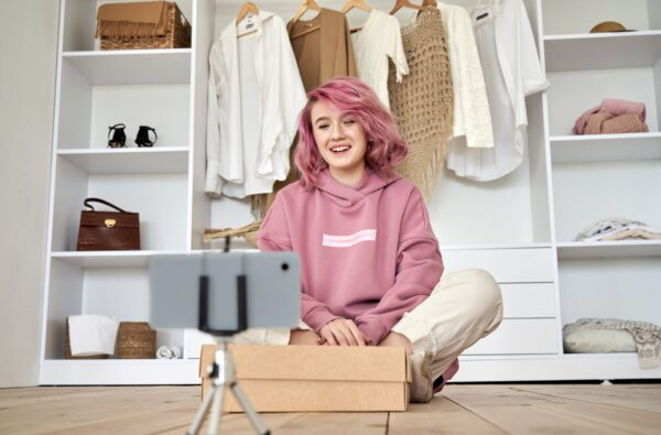 Fashion blogger recording an unboxing video
