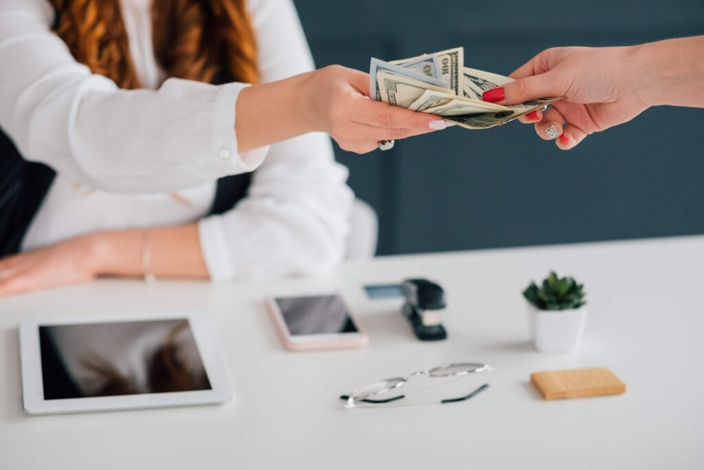 person handing cash to a consultant